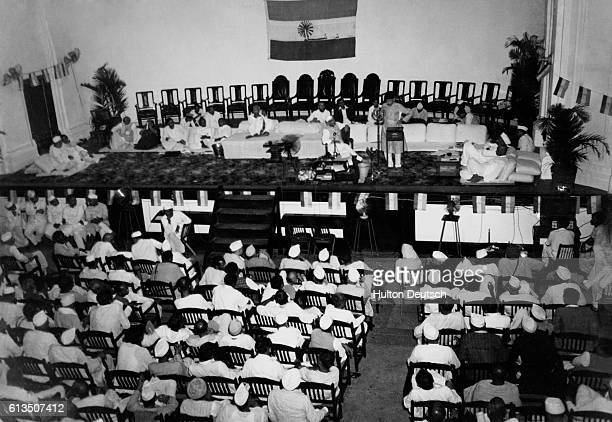 Incoming All India Congress Party President Jawaharlal Nehru and outgoing President Maulana Azad speak before delegates at a meeting in Bombay