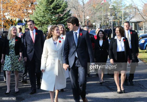 Incoming Canadian Prime Minister Justin Trudeau and his wife Sophie Gregoire arrive with his cabinet before his swearingin as Canada's 23rd prime...