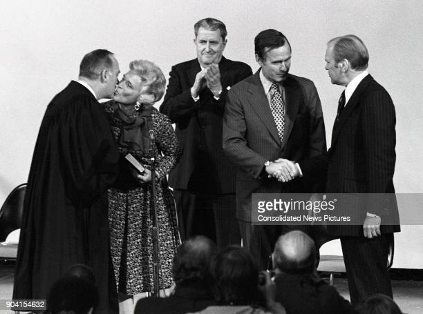 Incoming Central Intelligence Agency Director George HW Bush shakes hands with US President Gerald R Ford following the former's swearingin ceremony...