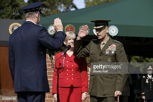 Incoming Chairman of the Joint Chiefs U.S. Marine Gen. Peter Pace, right, is sworn-in by outgoing Chairman of the Joint Chiefs of Staff U.S.A.F. Gen....