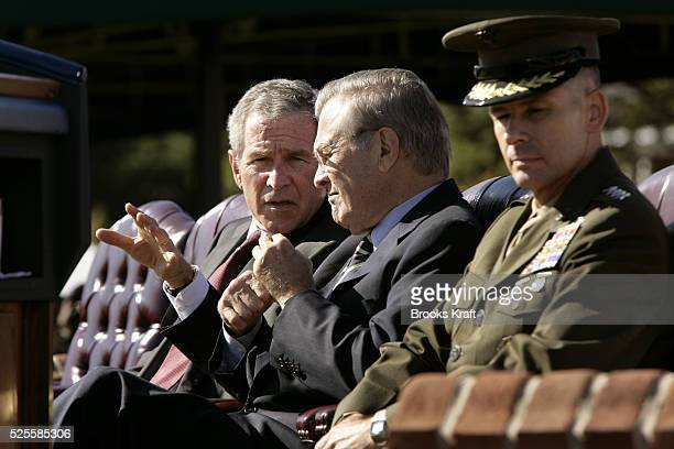 Incoming Chairman of the Joint Chiefs U.S. Marine Gen. Peter Pace, right, sits next to U.S. President George W. Bush, left,and Secretary of Defense...