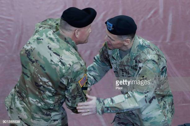 Incoming commander of the Eighth Army and South KoreaUS Combined Forces Command General Michael A Bills shakes hands with outgoing USFK's eighth Army...