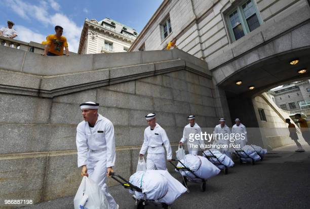 Incoming freshmen or plebes walk next to Bancroft Hall during Induction Day at the United States Naval Academy on Thursday June 28 2018 in Annapolis...