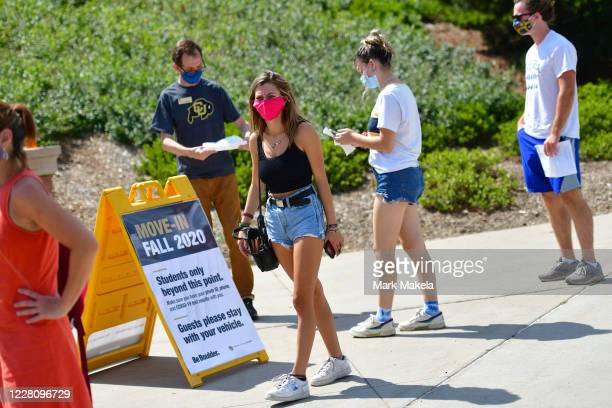 Incoming freshmen wait in line to ask questions at an informational tent while arriving on campus at University of Colorado Boulder on August 18,...