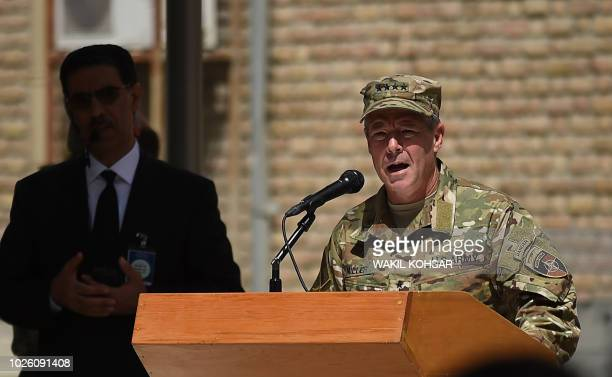 Incoming General Scott Miller command of US and NATO forces in Afghanistan gestures as he speaks during a change of command ceremony at Resolute...