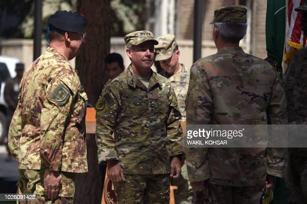 Incoming General Scott Miller command of US and NATO forces in Afghanistan US Army General Marchio and outgoing US Army General John Nicholson stand...