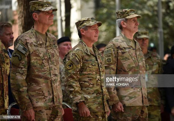 Incoming General Scott Miller command of US and NATO forces in Afghanistan outgoing US Army General John Nicholson and US army General Votel look on...