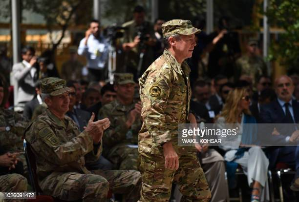 Incoming General Scott Miller command of US and NATO forces in Afghanistan walks during a change of command ceremony at Resolute Support in Kabul on...