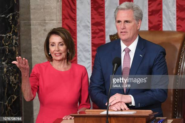 Incoming House Speaker Nancy Pelosi DCA shakes hands with Minority Leader Kevin McCarthy during the opening session of the 116th Congress at the US...