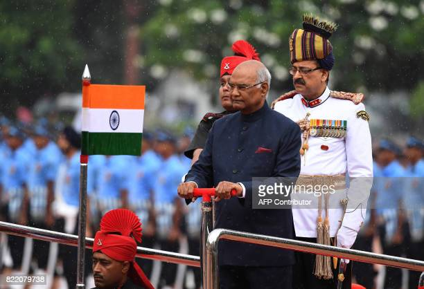 Incoming Indian president Ram Nath Kovind inspects a guard of honour during a ceremony at the Presidential Palace in New Delhi on July 25 2017 Ram...