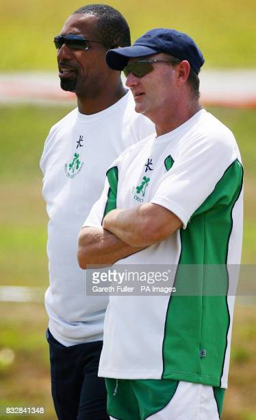 Incoming Irish coach Phil Simmons chats with current coach Adrian Birrell during a practice session at National Cricket Centre Balmin Couva Trinidad