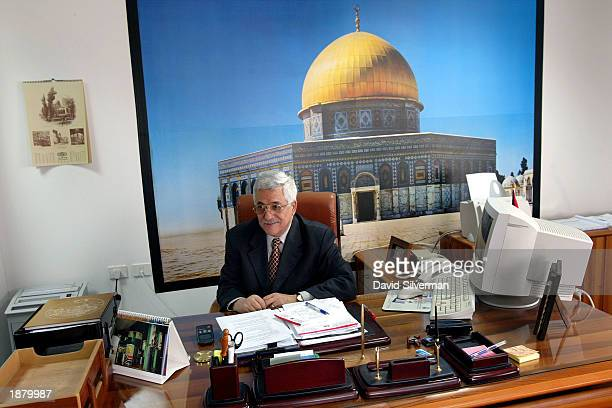 Incoming Palestinian Prime Minister Mahmoud Abbas also known as Abu Mazen sits in his office March 27 2003 in the West Bank city of Ramallah Abbas...