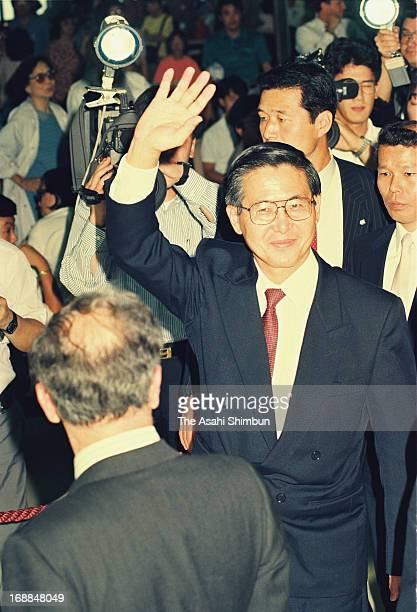 Incoming Peruvian President Alberto Fujimori waves upon departure at New Tokyo International Airport on July 5 1990 in Narita Chiba Japan Narita...