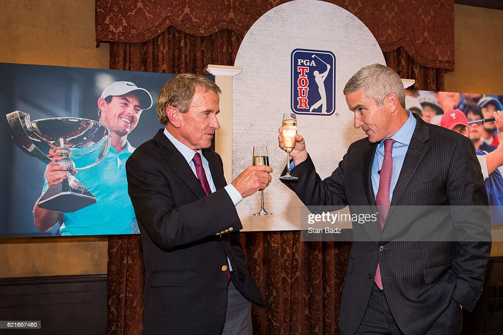 Incoming PGA TOUR Commissioner Jay Monahan, right, raises a glass to outgoing Commissioner Tim Finchem during the PGA TOUR You Employee Meeting in the Ponte Vedra Room at TPC Sawgrass on November 7, 2016 in Ponte Vedra Beach, Florida.