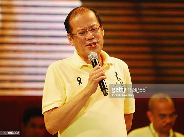 Incoming Presidentelect Benigno 'Noynoy' Aquino sings during the inauguration street party of Aquino as the fifteenth President of the Philippines at...