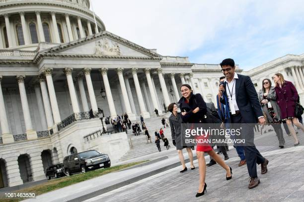 Incoming Rep Alexandria OcasioCortez and other freshman members of the 116th Congress their staff and loved ones arrive for a group photo on Capitol...