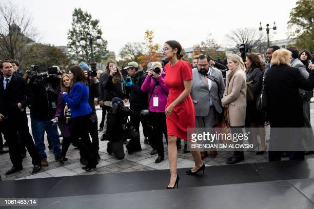 Incoming Rep Alexandria OcasioCortez leaves after a group photo with freshman members of the 116th Congress on Capitol Hill November 14 2018 in...