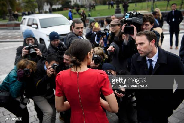 Incoming Rep Alexandria OcasioCortez speaks to reporters after a group photo with freshman members of the 116th Congress on Capitol Hill November 14...