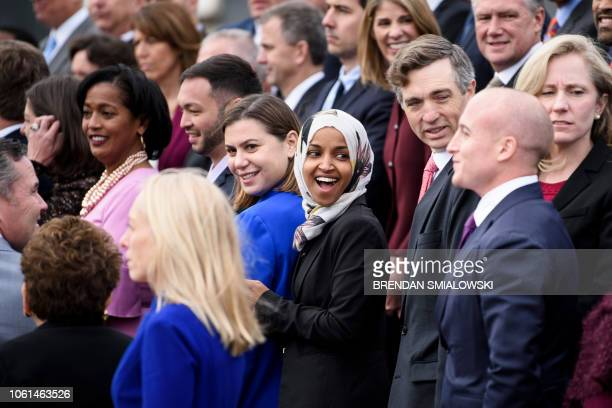 Incoming Rep Ilhan Omar and other freshman members of the 116th Congress pose for a group photo on Capitol Hill November 14 2018 in Washington DC