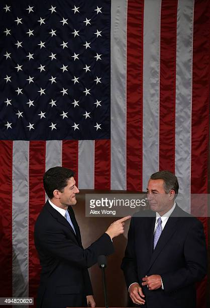 Incoming Speaker of the House Rep Paul Ryan points at outgoing US Speaker of the House Rep John Boehner in the House Chamber of the Capitol October...