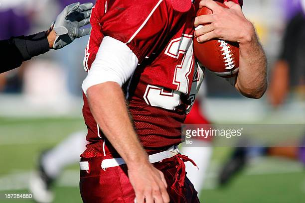 incoming tackle - quarterback stock pictures, royalty-free photos & images