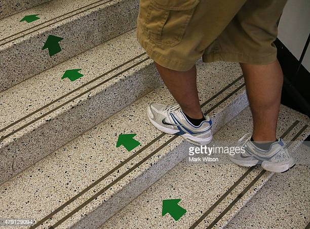 Incoming US Navy plebes or freshmen follow the green arrows while checking in at the US Naval Academy July 1 2015 in Annapolis Maryland Over 1193...