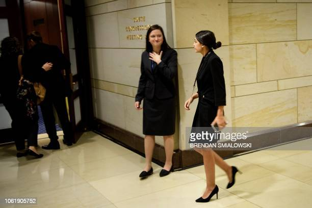 Incoming US Representative Alexandria OcasioCortez arrives for a House of Representatives memberelect welcome briefing on Capitol Hill November 15...