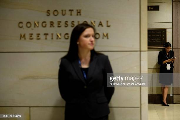 Incoming US Representative Alexandria OcasioCortez waits for a House of Representatives memberelect welcome briefing on Capitol Hill November 15 2018...