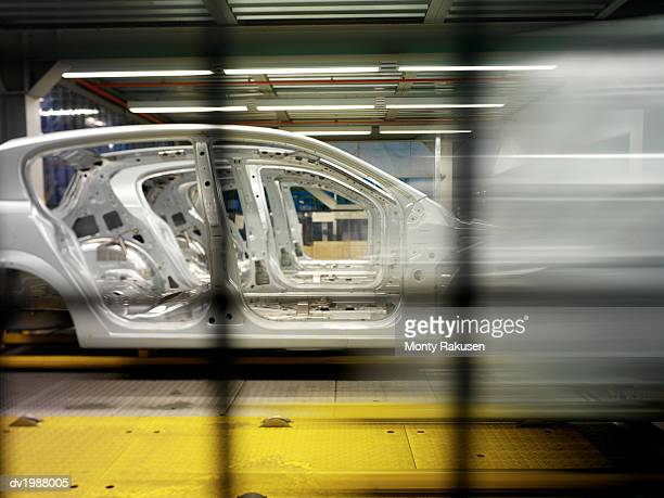Incomplete Car Parts on a Factory Assembly Line