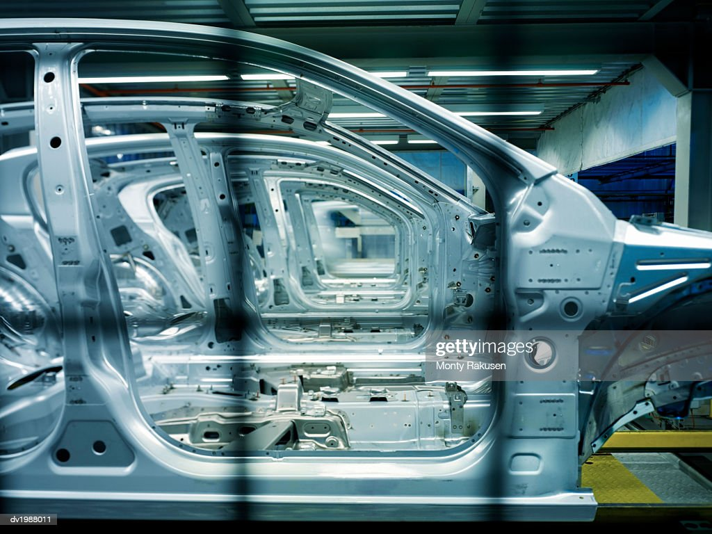 Incomplete Cars on a Factory Assembly Line : Stock Photo
