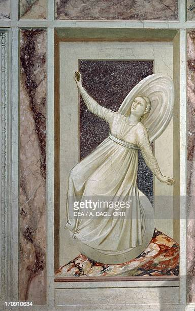 Inconstancy female figure rolling down a slope precariously balanced on a wheel by Giotto detail from the cycle of frescoes The Vices and Virtues...