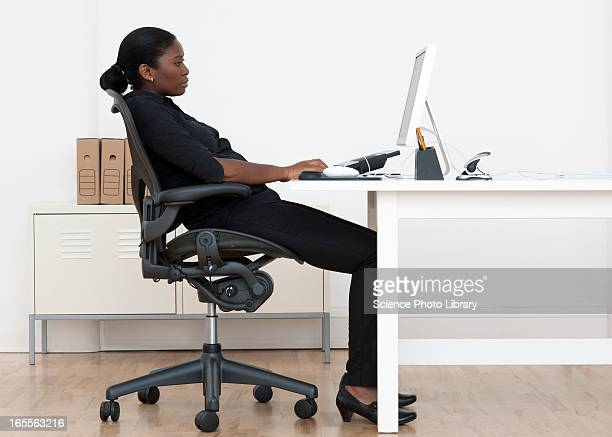 incorrect seated posture - bad posture stock pictures, royalty-free photos & images