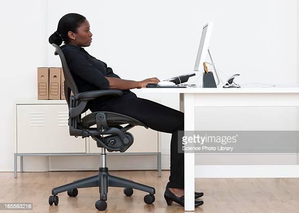 incorrect seated posture - lichaamshouding stockfoto's en -beelden