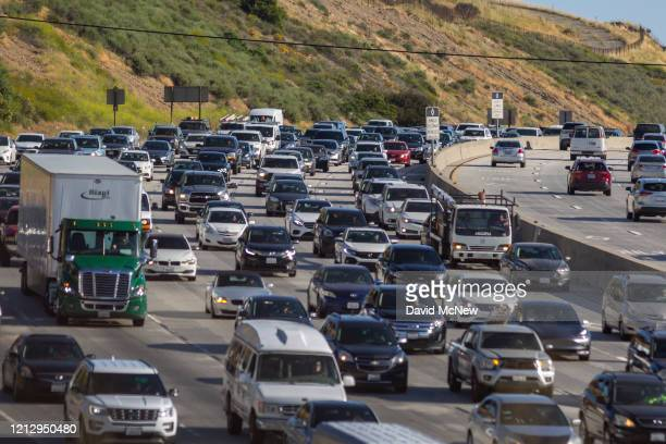 Increasing afternoon commuter traffic streams northward from Los Angeles on the State Route 14 freeway as more people take to the roadways while the...