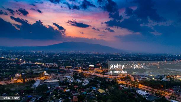 incredible Bird eye view sunset chiangmai city landscape ring road and traffic