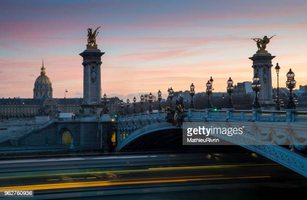 incredible sunset in invalides in paris, city of love and of light - les invalides quarter stock photos and pictures