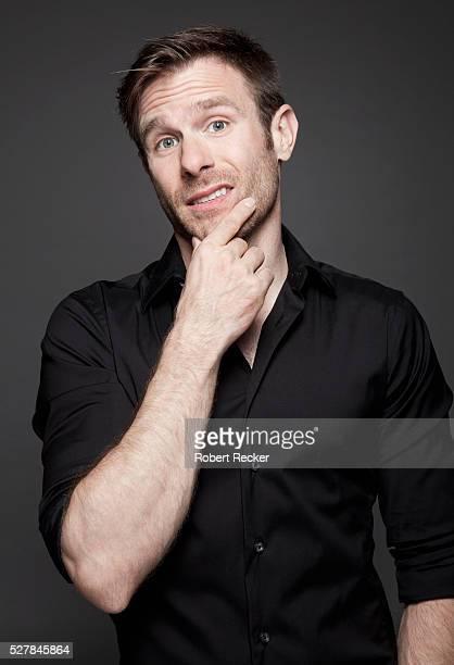 incredulously mid-adult man - 黒のシャツ ストックフォトと画像