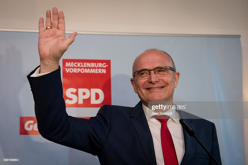 Incumbant gubernatorial candidate of the German Social Democrats (SPD) Erwin Sellering celebrates after initial elections results gave the SPD 30.4% of the vote in state elections in the German state of Mecklenburg-Western Pomerania on September 4, 2016 in Schwerin, Germany. The German Christian Democrats (CDU), who had been neck and neck with the SPD in polls in weeks before the elections, lost ground in what many see as a reflection of declining support for German Chancellor Angela Merkel, who is also CDU chairwoman. Meanwhile the Alternative for Germany (Alternative fuer Deutschland, or AfD), a newcomer, populist party that also attracts right-wing voters, has shot forward to gain XX% and will be a significant opposition force in the state parliament.
