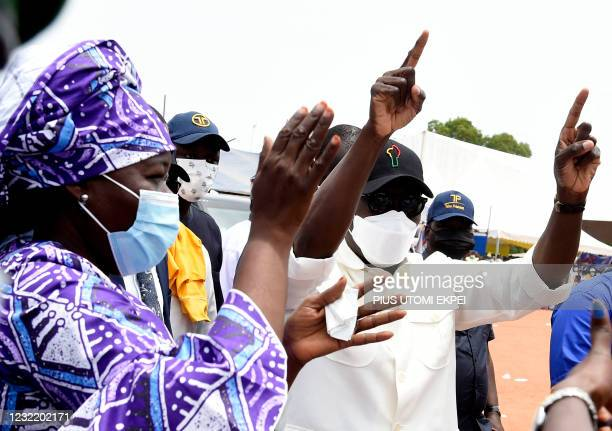 Incumbent Benin President Patrice Talon and running mate Mariam Talata waves to supporters during a campaign rally at Abomey-Calavi, Benin, on April...
