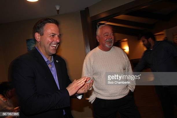 LAUSD incumbent candidate Richard Vladovic is greeted by city councilman Joe Busciano as he arrived to meet his supportershis at the Ports OâCall...