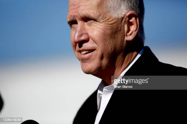Incumbent candidate Sen. Thom Tillis speaks to the media before U.S. President Donald Trump arrives to deliver remarks during a campaign rally at...