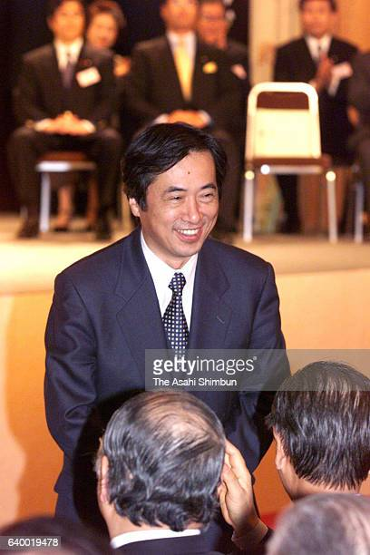 Incumbent Democratic Party of Japan President Naoto Kan applauds his fellow lawmakers after being reelected after the party's presidential election...