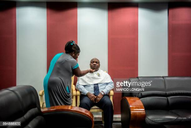 TOPSHOT Incumbent Gabonese President Ali Bongo Ondimba sits for make up ahead of tonight's televised electoral debate on August 24 2016 at the Gabon...