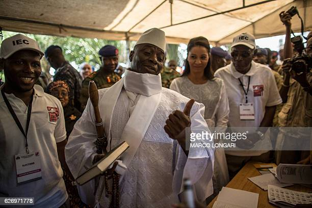 Incumbent Gambian president Yahya Jammeh gestures before casting his marble in a polling station in a presidential poll, in Banjul on December 01,...