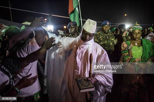 Incumbent Gambian President Yahya Jammeh, leader of the APRC greets his suporters in Bikama on November 24, 2016 during an electoral rally. As...