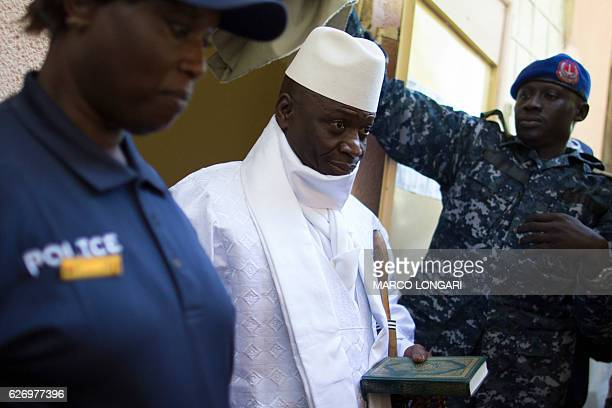 Incumbent Gambian president Yahya Jammeh leaves the polling booth after casting his marble for presidential election in a polling station, in Banjul...