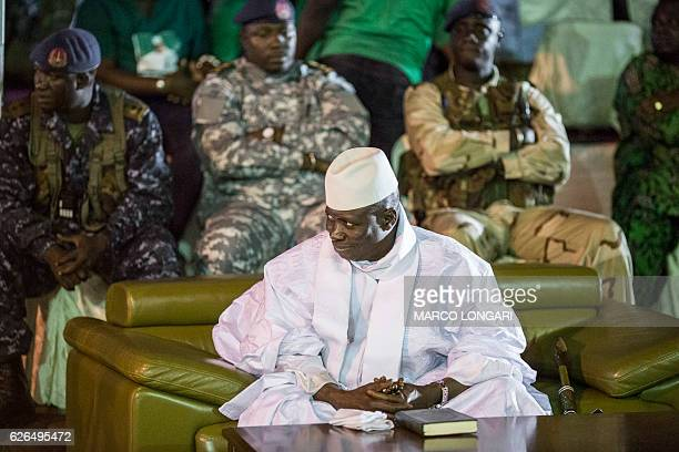 Incumbent Gambian President Yahya Jammeh looks on in Banjul on November 29 during the closing rally of the electoral campaign of the Alliance for...