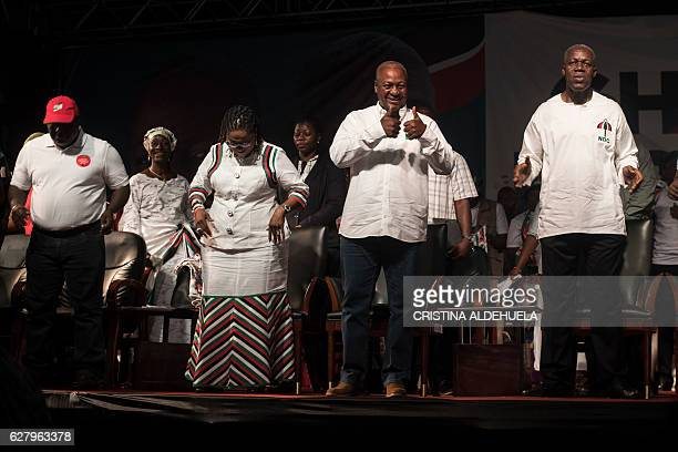 Incumbent Ghana president John Dramani Mahama of the NDC and Kwesi AmissahArthur Vice President of Ghana gesture as they attend in the Accra Sports...
