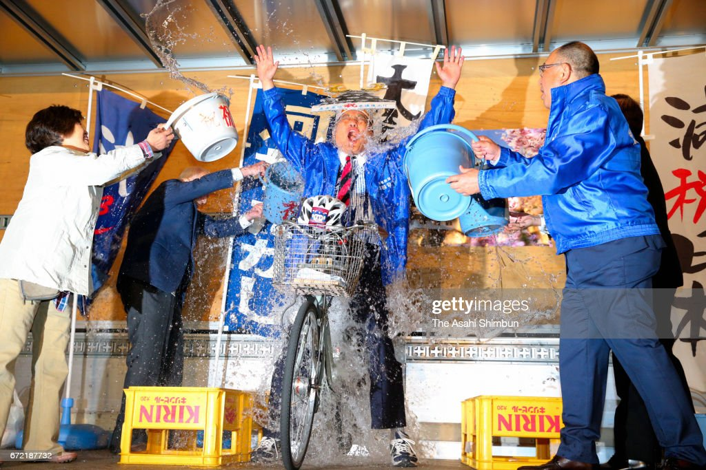 Incumbent Nagoya City Mayor Takashi Kawamura is doused with warter to celebrate winning his fourth term at his election campaign headquarters on April 23, 2017 in Nagoya, Aichi, Japan.