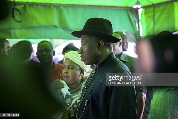 Incumbent Nigerian president Goodluck Jonathan arrives to cast his ballot during presidential elections at polling station in Otuoke on March 28 2015...